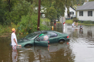 Flood car in front of house